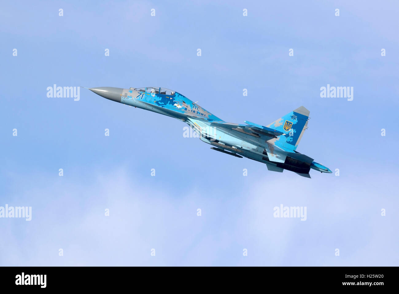 Ukrainian Air Force Sukhoi Su-27UB [71] making a rehearsal flight over the east coast for the upcoming airshow in - Stock Image