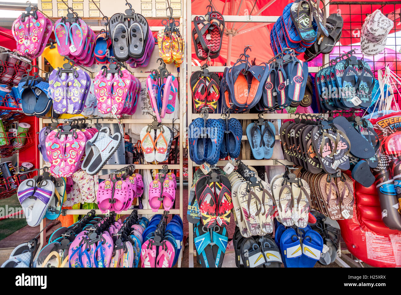 Beach shoes for sale in a Cyprus market - Stock Image