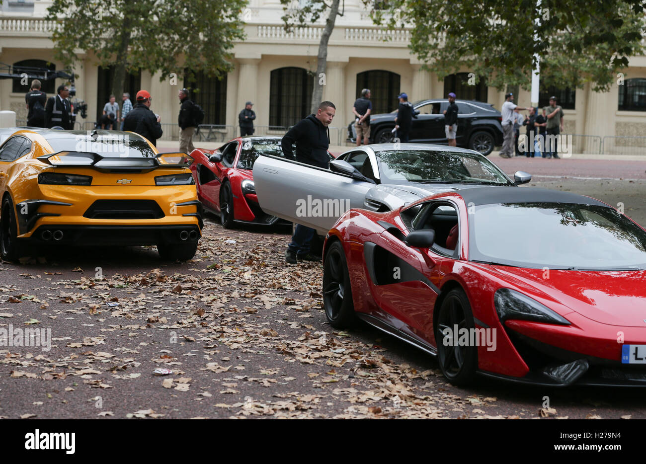 A Chevrolet Camaro (left In Yellow), Aston Martin DB11 (centre In Silver)  And A McLaren (right In Red) Sports Car During Filming Of The Film  Transformers: ...
