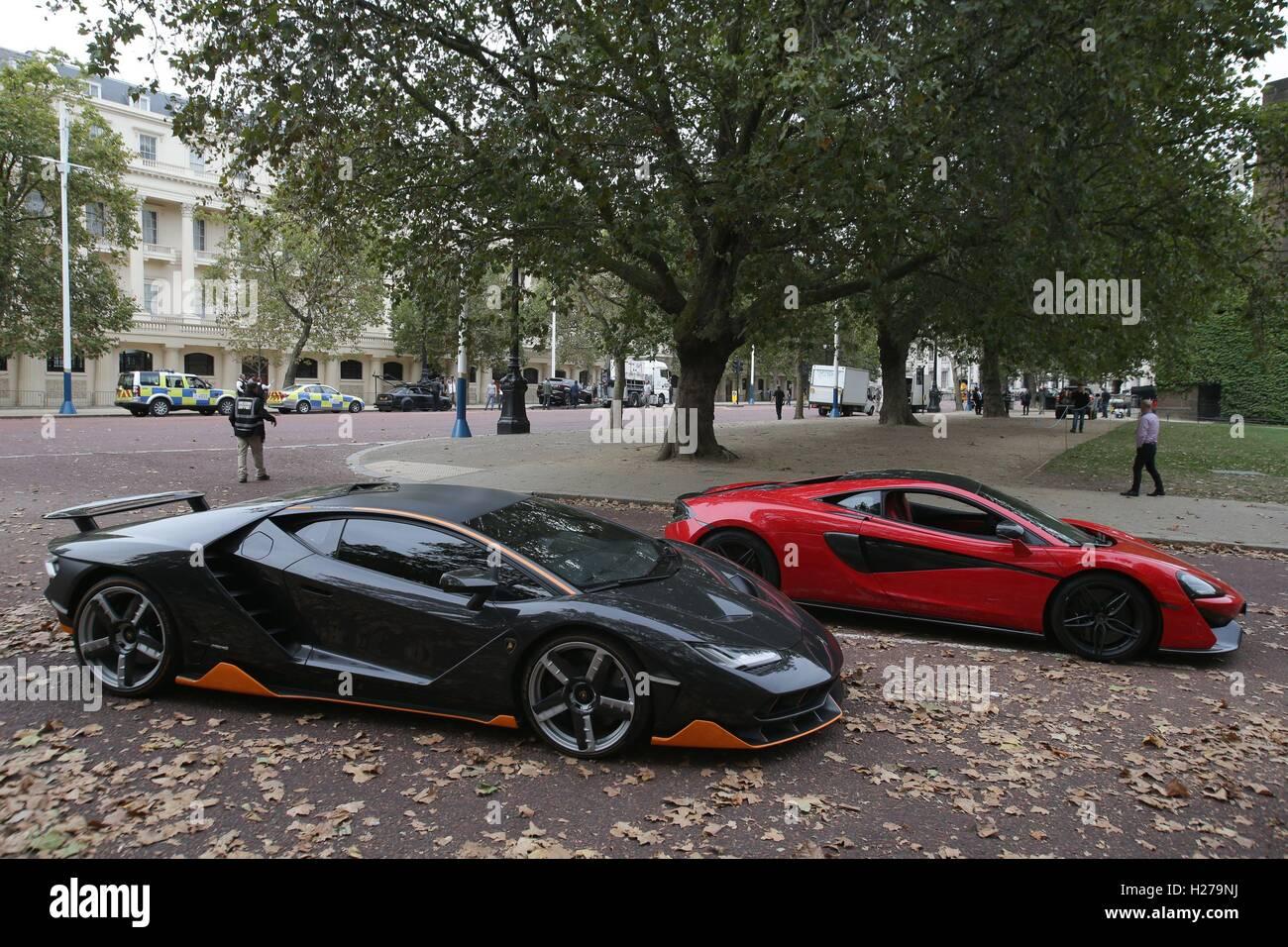 A Lamborghini Centenario Left And Mclaren Sports Car During