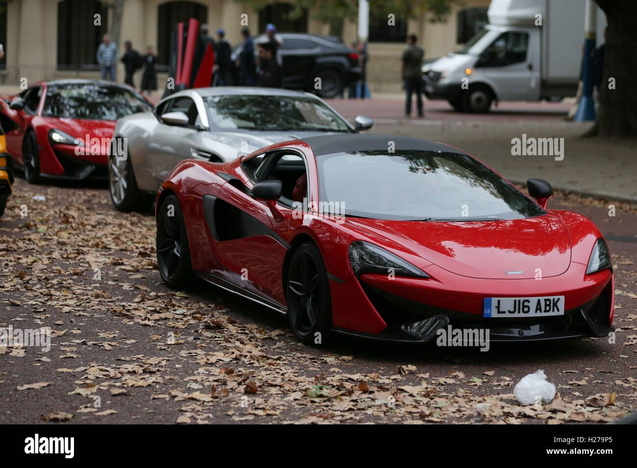 A McLaren (front In Red) Sports Car During Filming Of The Film Transformers:  The Last Knight, On The Mall In London.