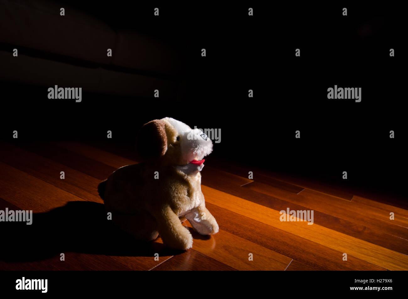 Plush dog doll toy sitting obedient Stock Photo