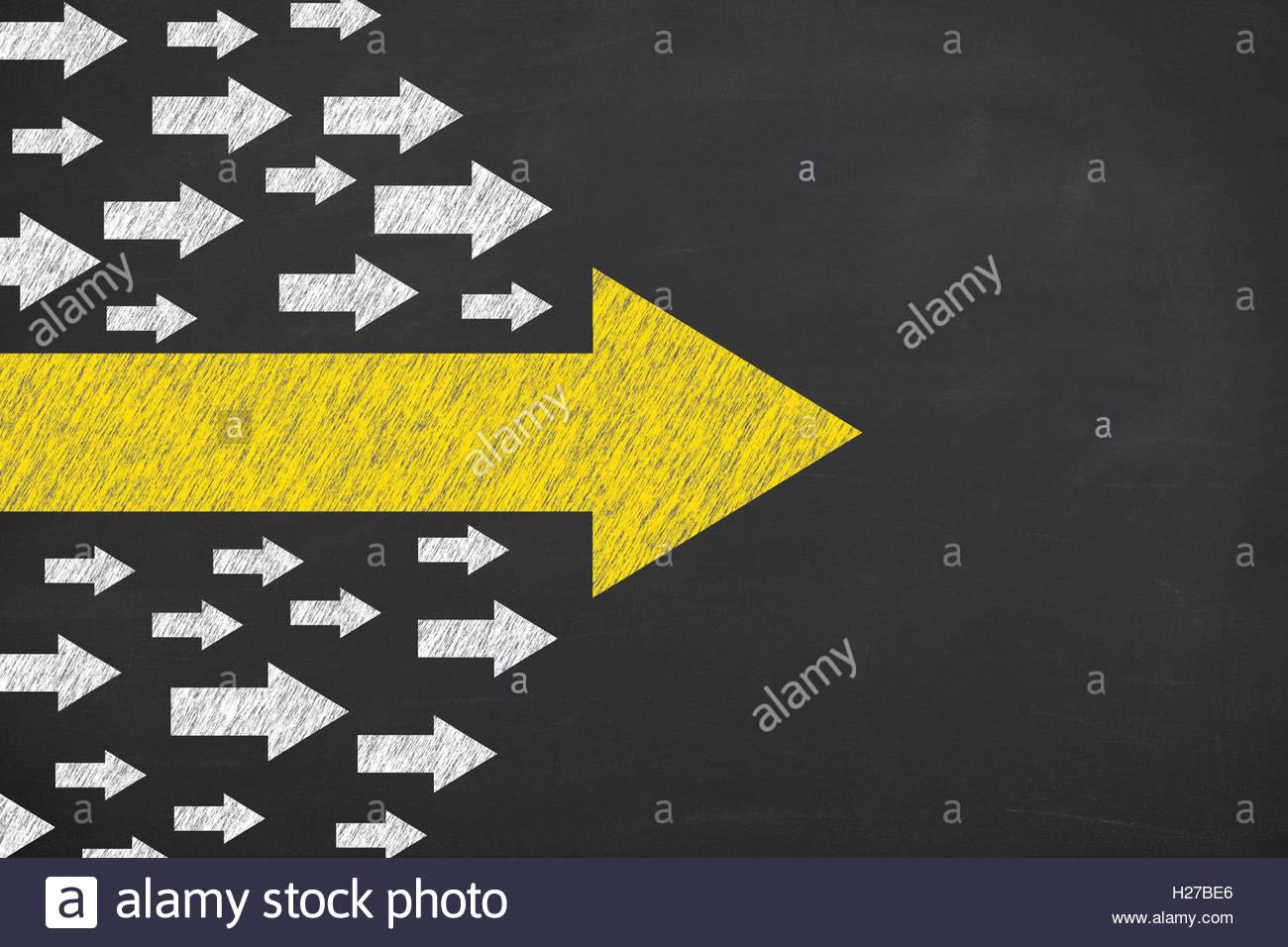 Arrows Leadership Concept on Blackboard Background - Stock Image