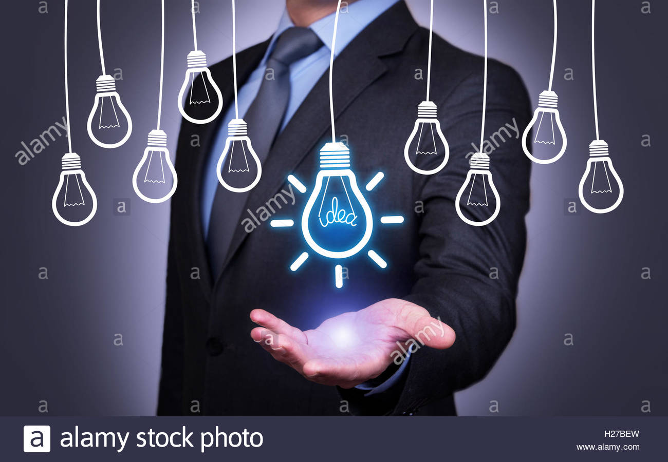 Human Holding his Hand Above the Idea Bulb - Stock Image