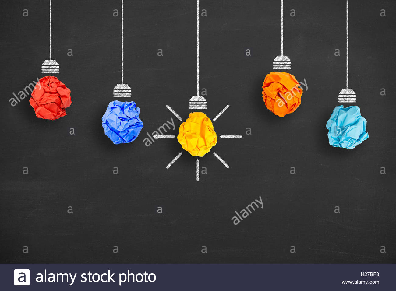 Idea Concept Crumpled Paper Light Bulb on Blackboard Background - Stock Image