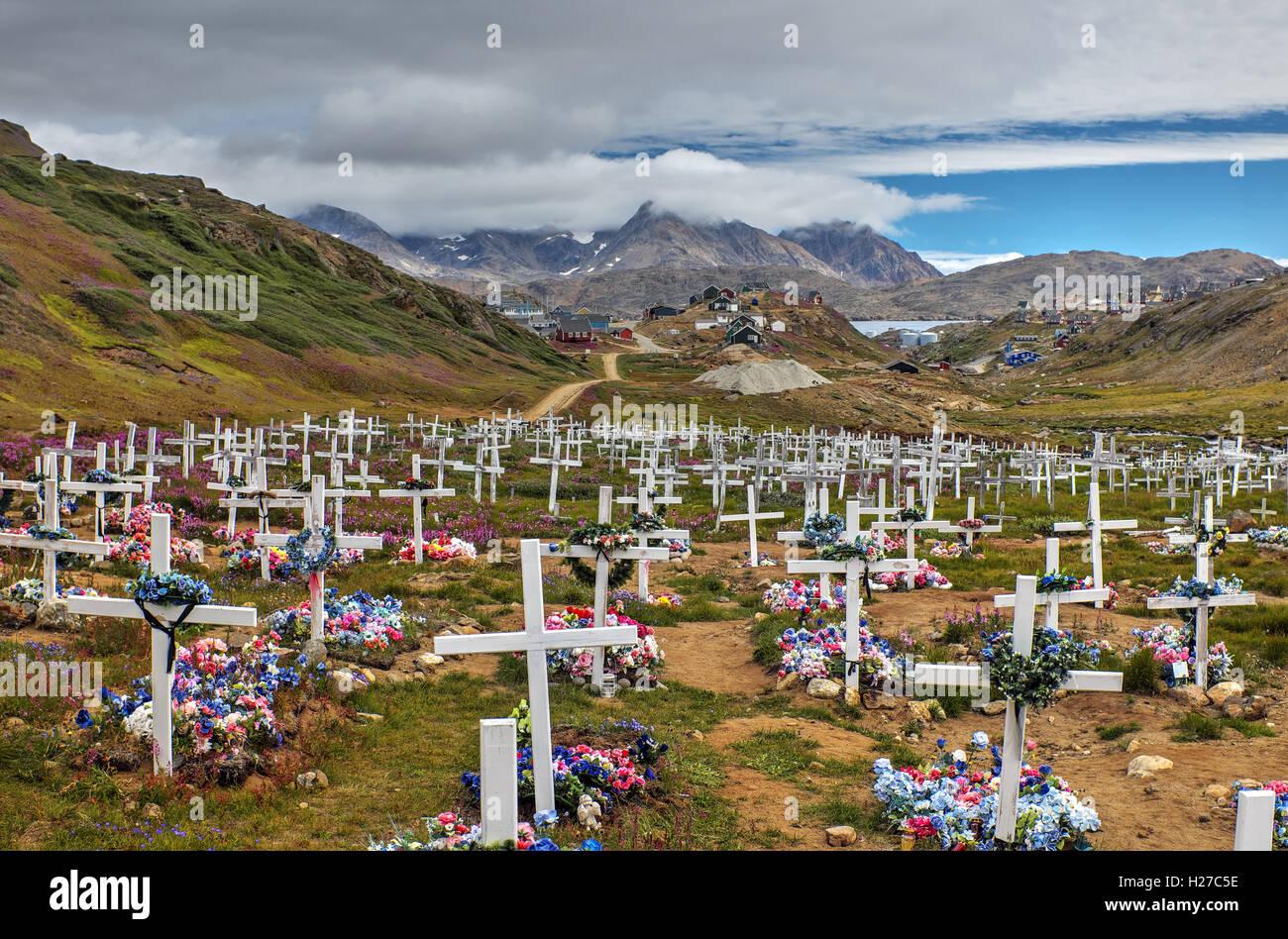 Cemetery outside town of Tasiilaq on Ammassalik Island, East Greenland Stock Photo