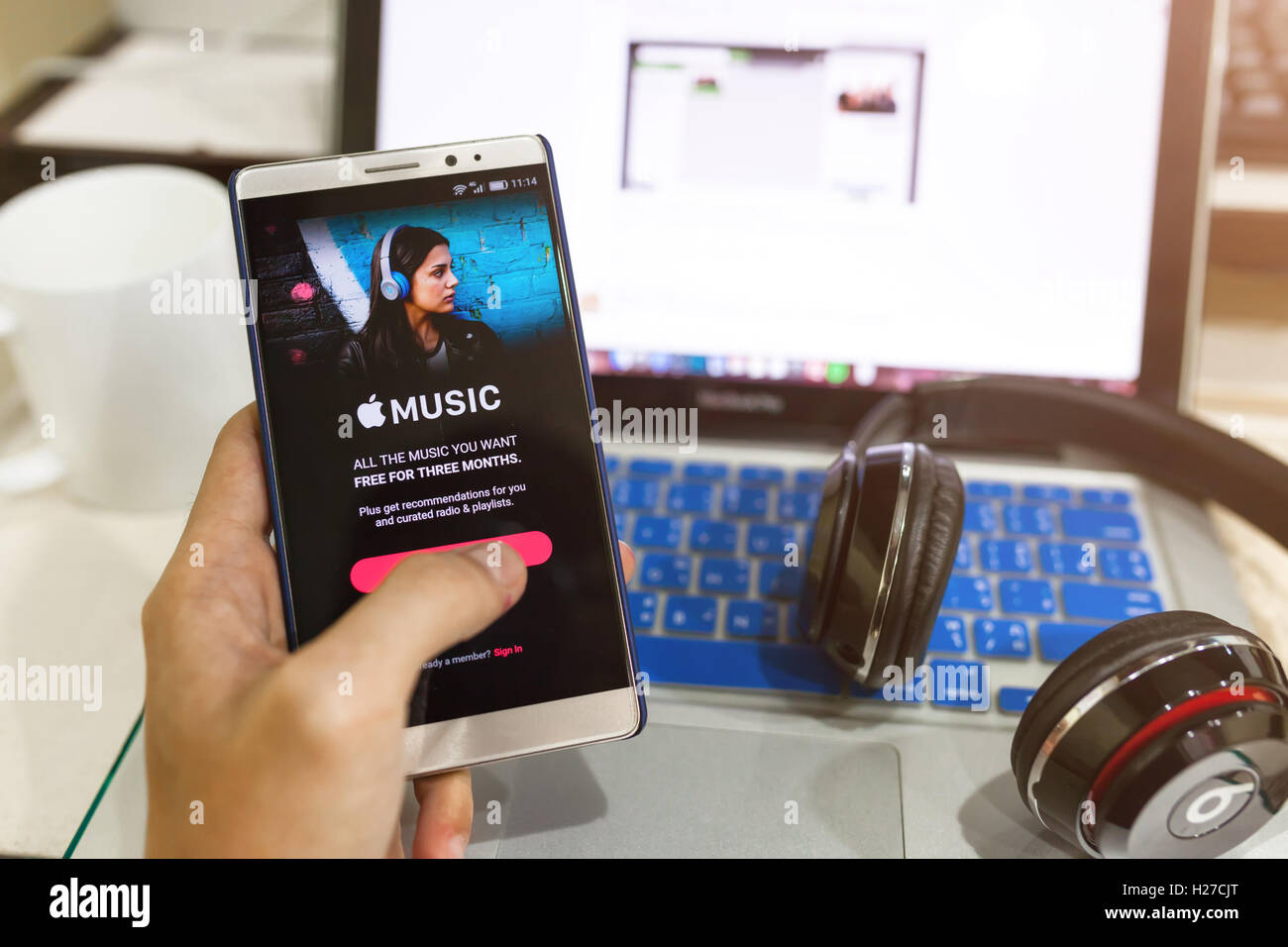 CHIANG MAI,THAILAND - Sept 25,2016: A man hand holding screen shot of Apple music app showing on Android. Apple Stock Photo