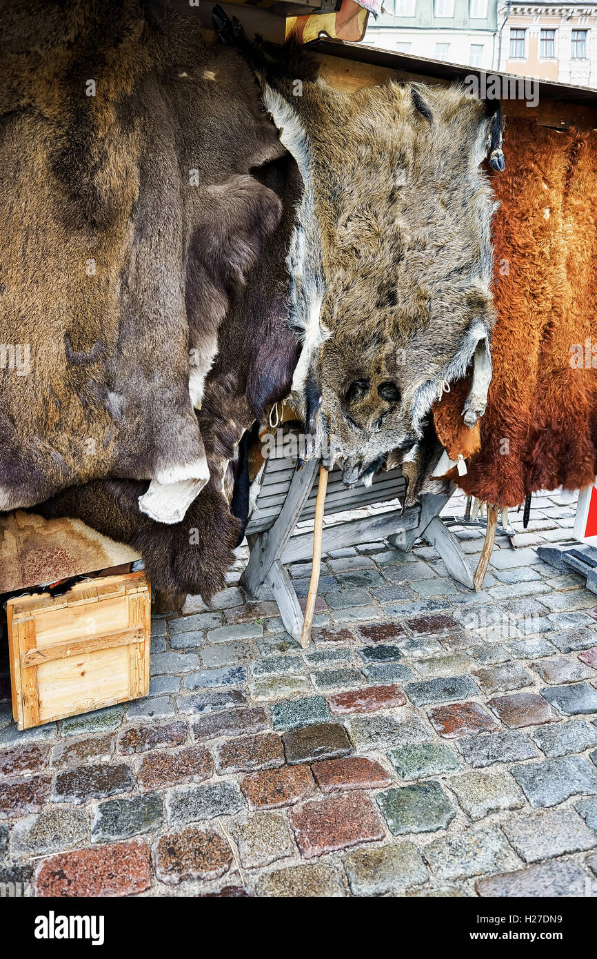 Different types of animal skin on sale at the Christmas Market in Riga, Latvia. The market is a traditional part - Stock Image