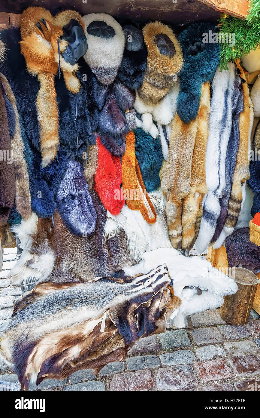 Riga, Latvia - December 25, 2015: Natural animal skin and warm clothes made of fur on the display during the Christmas - Stock Image