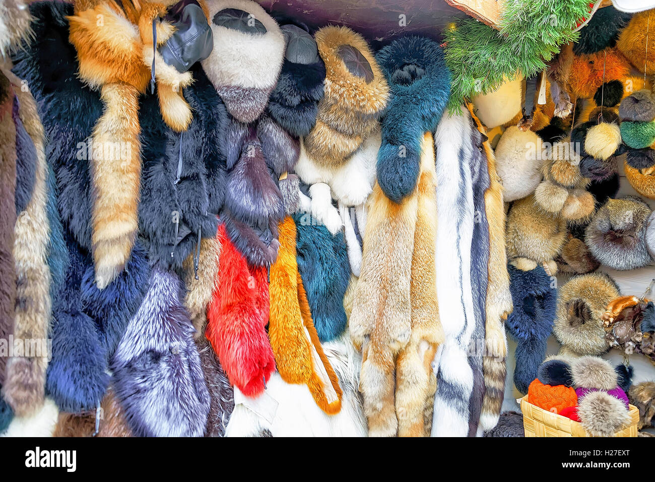 Riga, Latvia - December 25, 2015: Clothes made from animal skin and fur on the display at stall during the Riga - Stock Image
