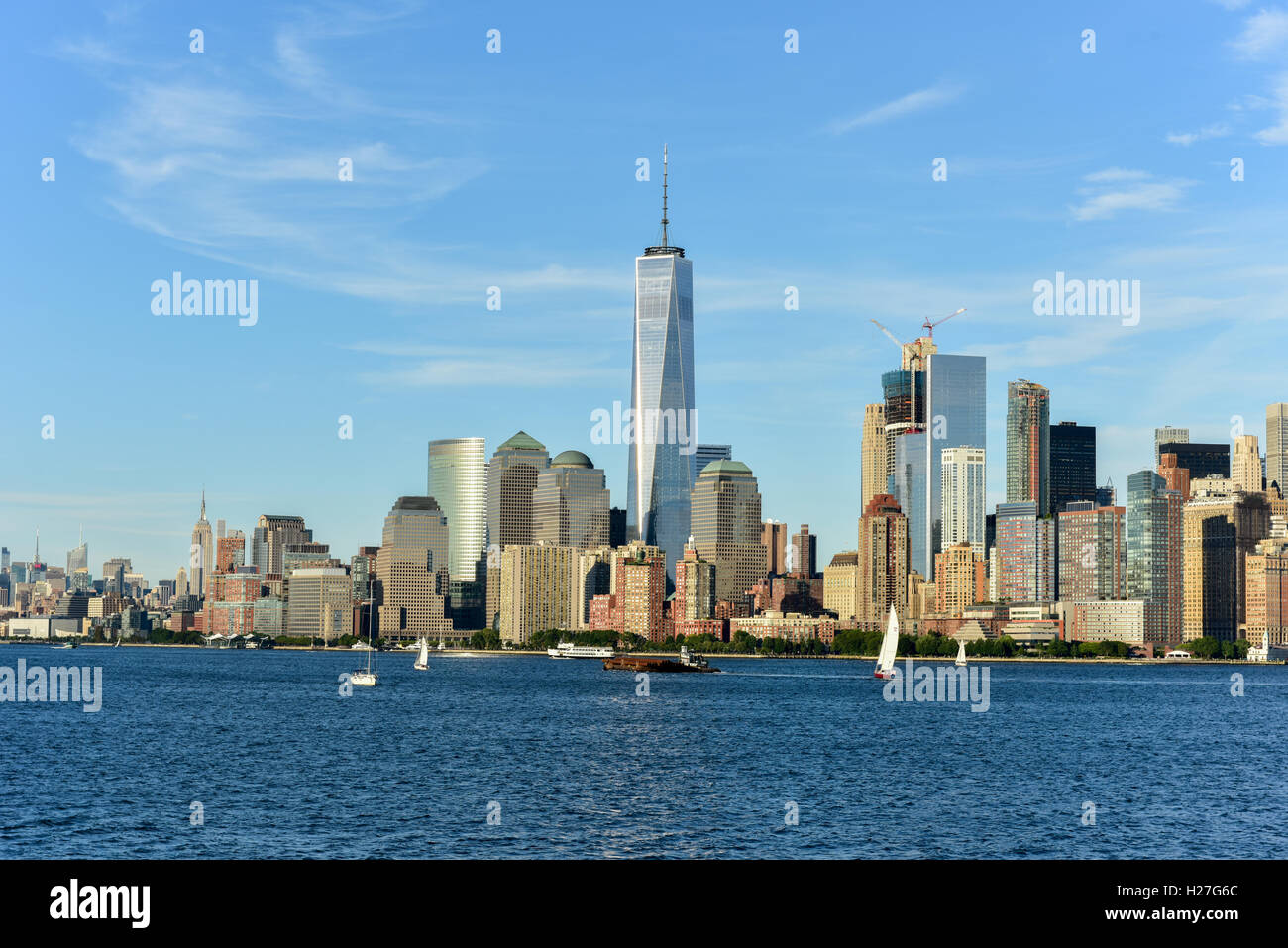 View of the New York City skyline on a summer day. - Stock Image