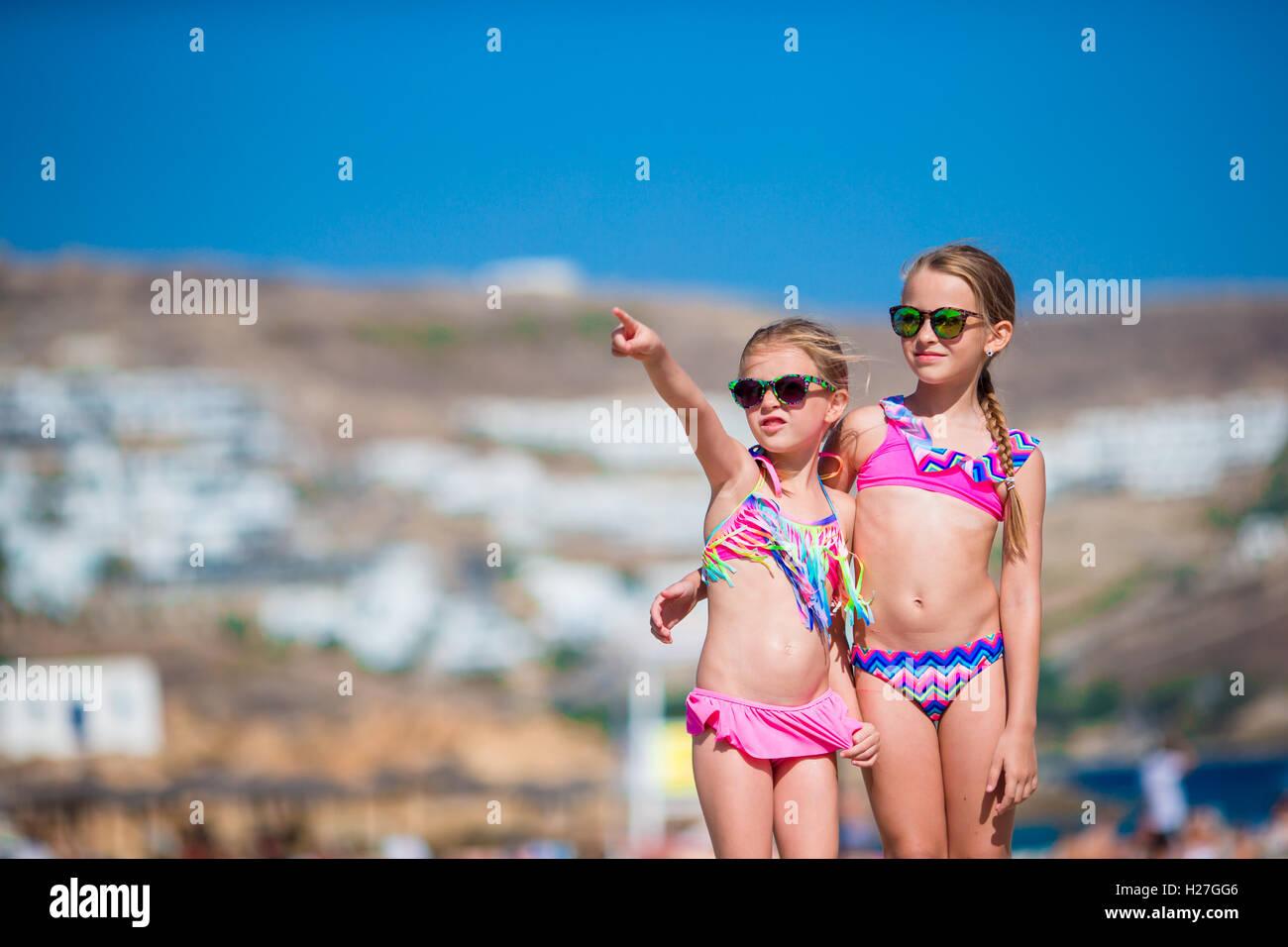 31c450cd6a86d Adorable little girls having fun during beach vacation on Mykonos ...