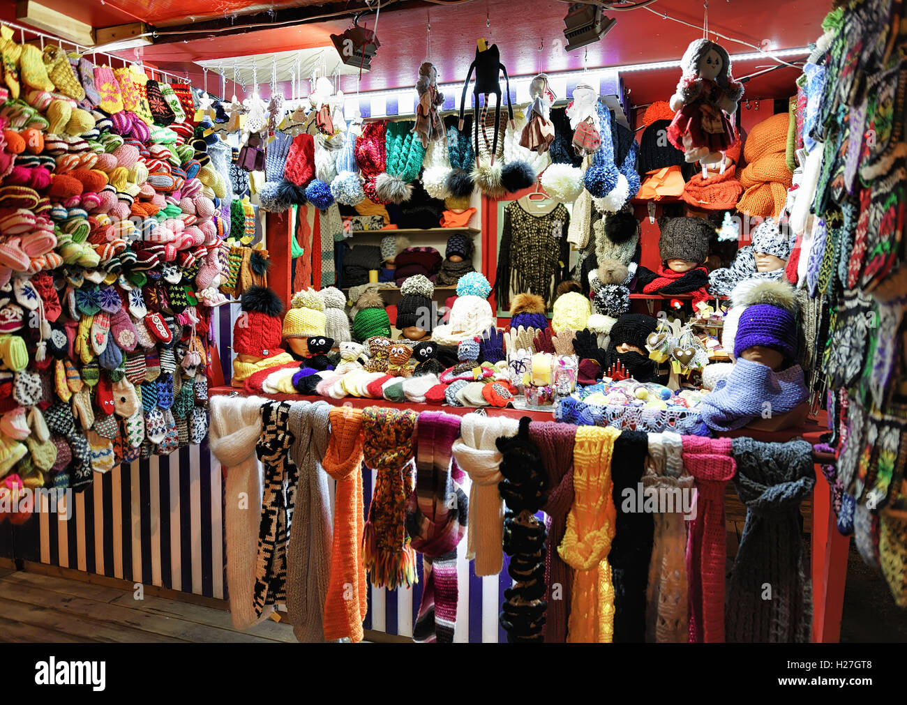 Warm colorful mittens, gloves, socks and hats at one of the stalls at the street Christmas Market in Riga, Latvia. Stock Photo