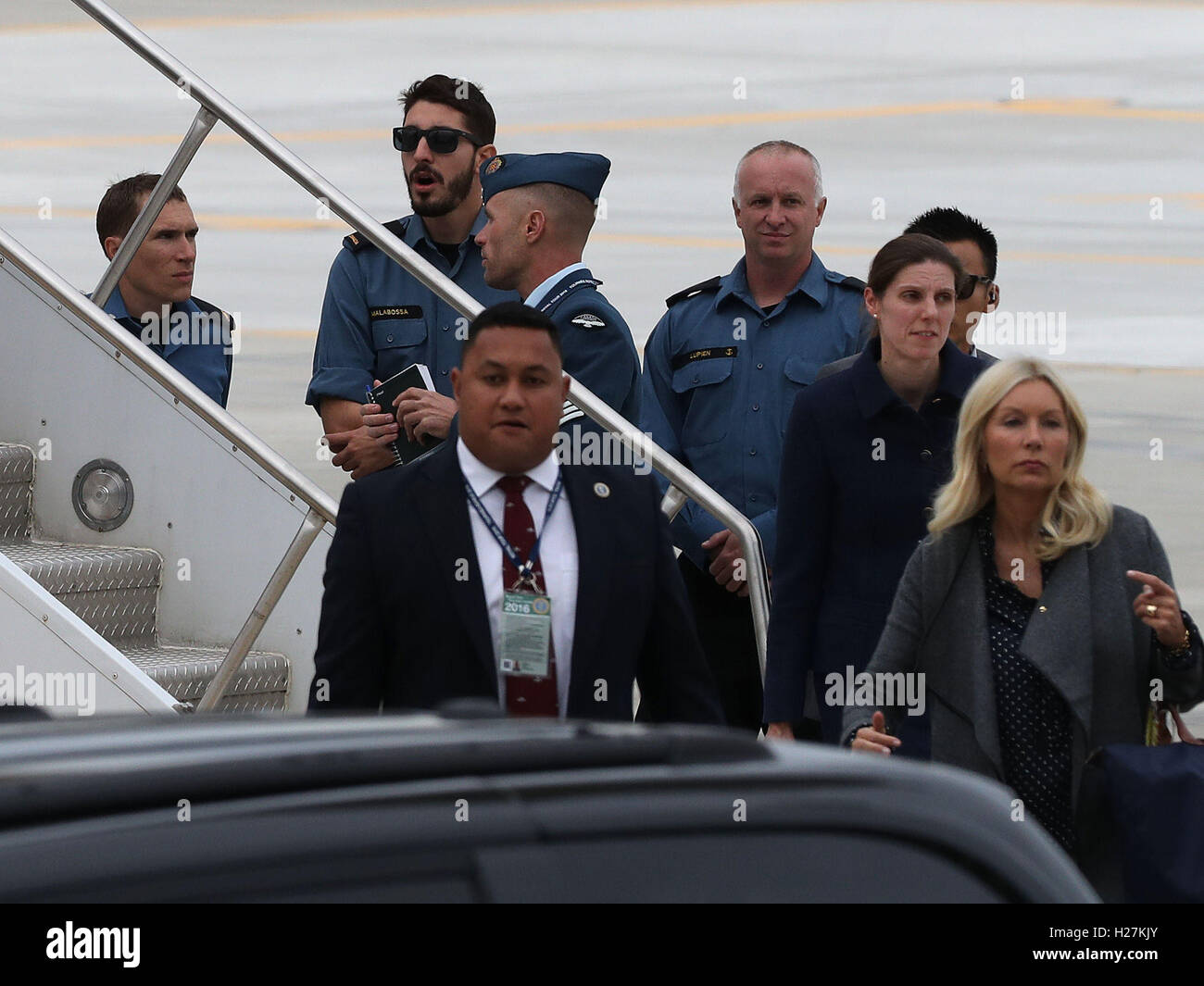 Hairdresser Amanda Cook Tucker(blonde hair) and nanny Maria Barrallo gets off the plane after arriving with The - Stock Image