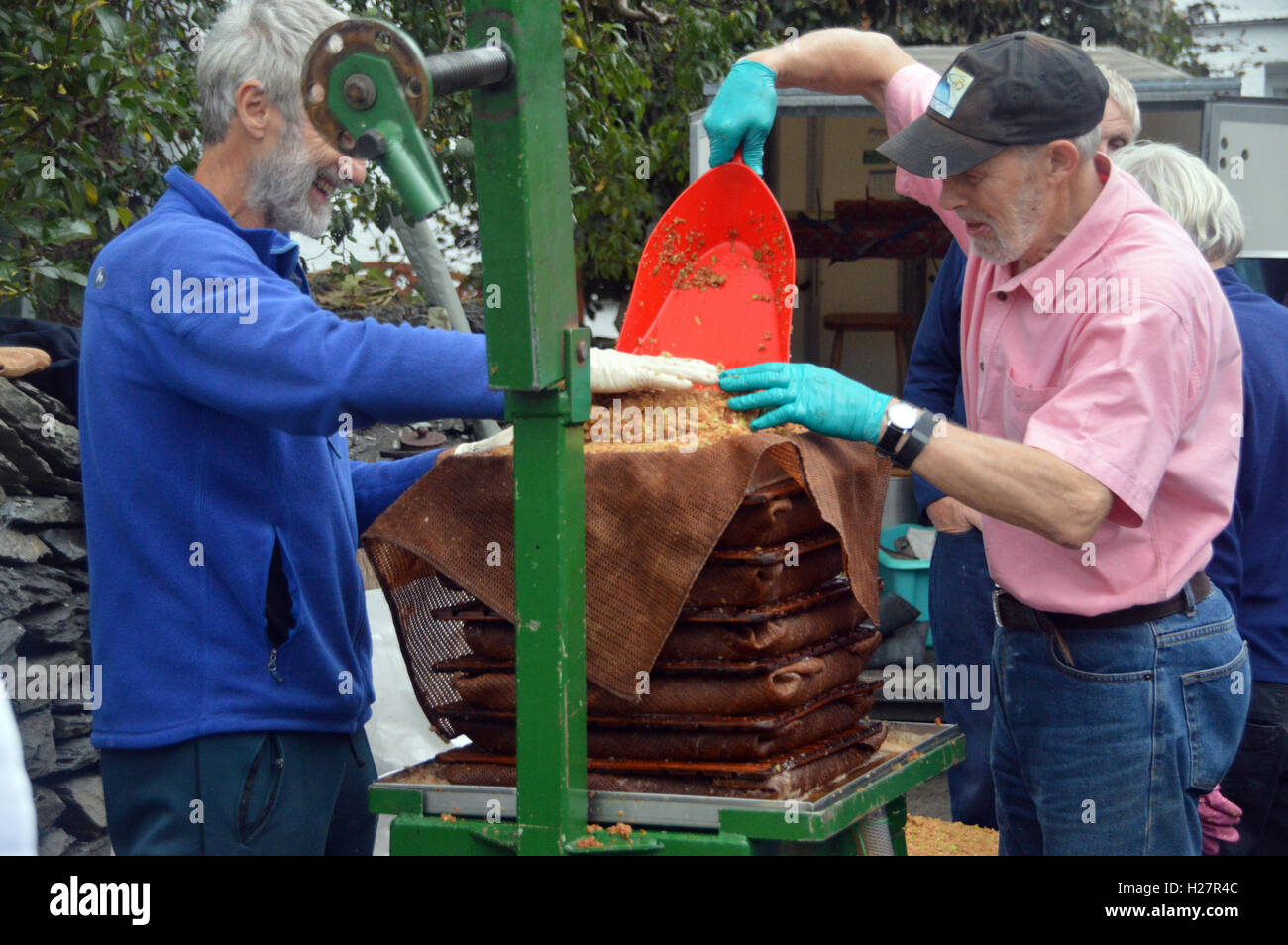 Apple Pressing by South Lakeland Orchard Group Outside Wilf''s Café Mill Yard, Staveley, Lake District - Stock Image