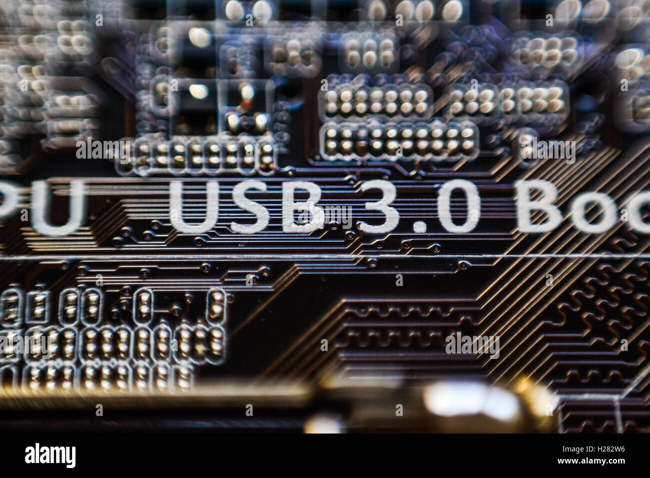 USB 3.0 inscription on motherboard micro chip circuit Stock Photo