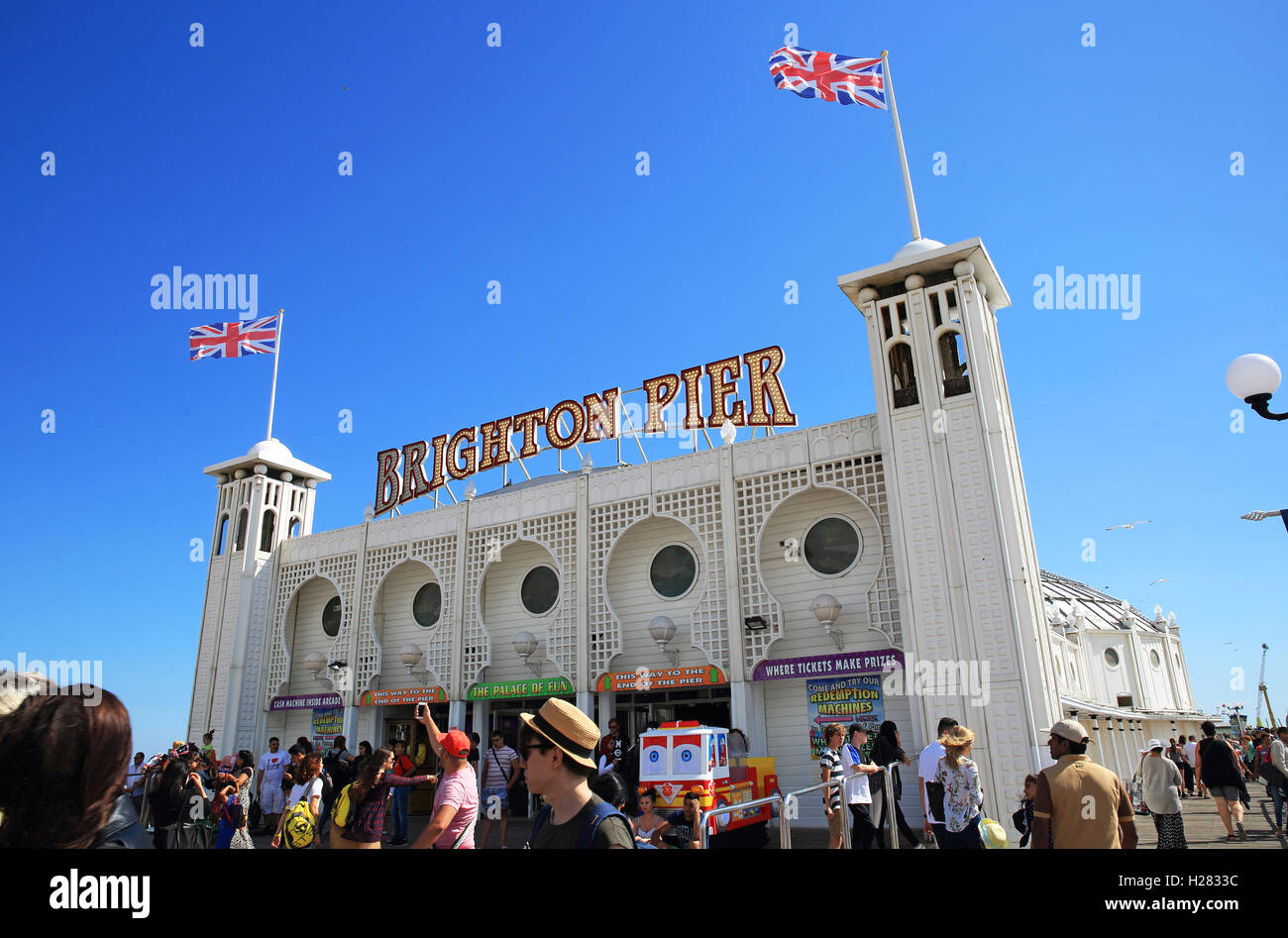 The entrance to the iconic Palace Pier, in Brighton, on a warm, summer's day, in East Sussex, England, UK - Stock Image