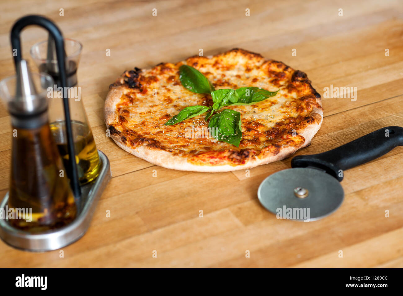 Pizza is ready, please help yourself - Stock Image
