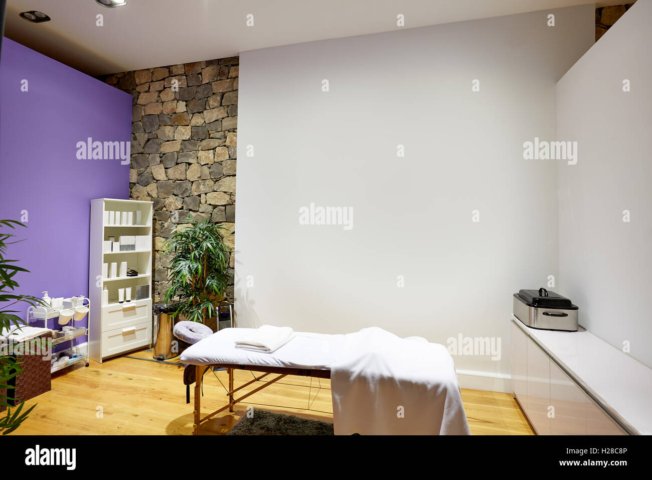 Massage room with massage table and products with stone wall Stock ...