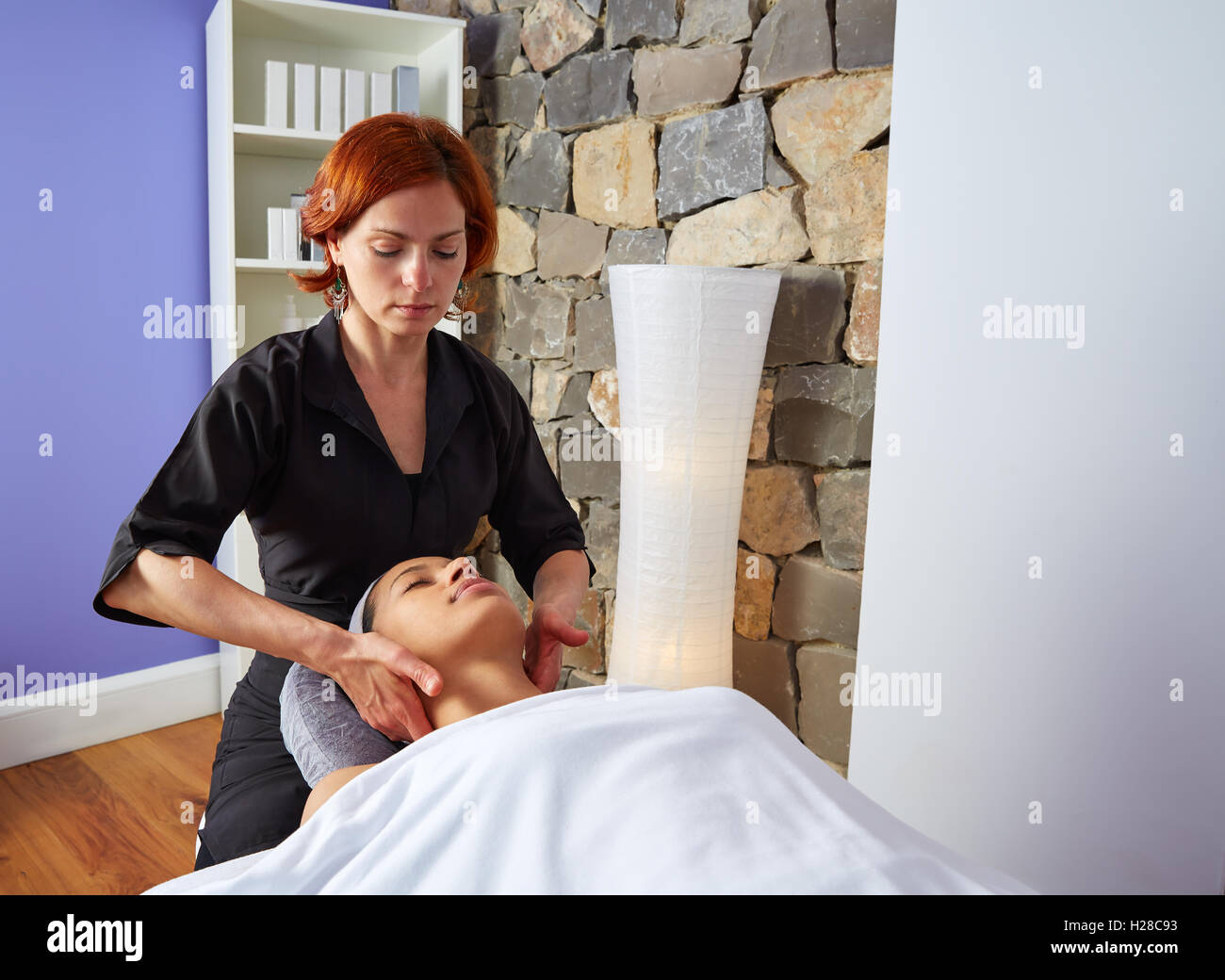 Shoulders and neck massage woman with physiotherapist Stock Photo