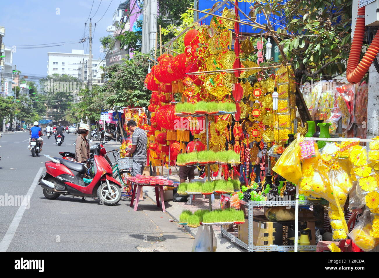 Nha Trang, Vietnam - February 7, 2016: Red lanterns and lucky items are for sale in the lunar new year on the street - Stock Image