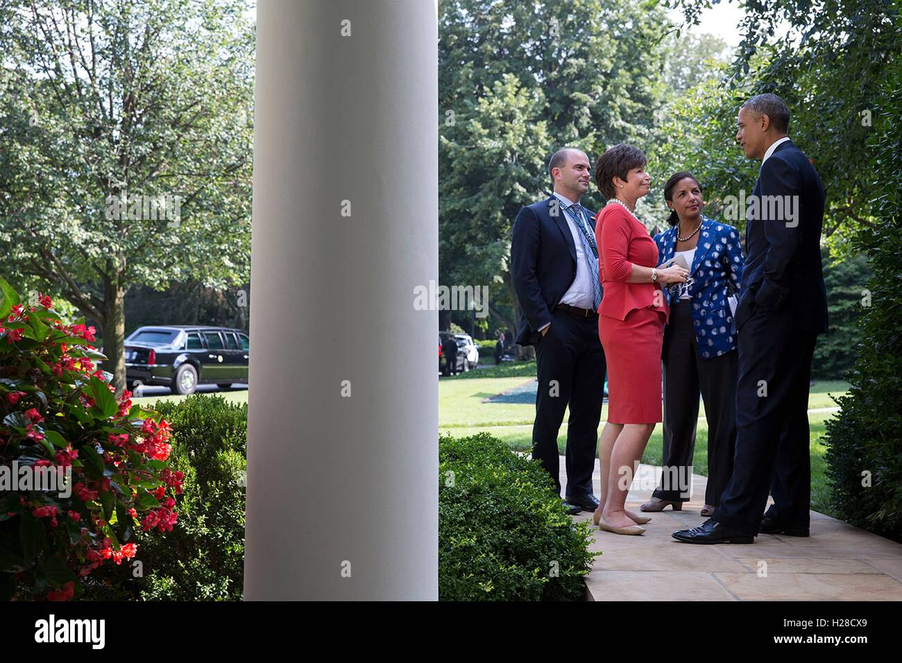 U.S. President Barack Obama talks with National Security advisors outside the White House Oval Office during the U.S.-Africa Business Forum August 5, 2014 in Washington, DC. Stock Photo