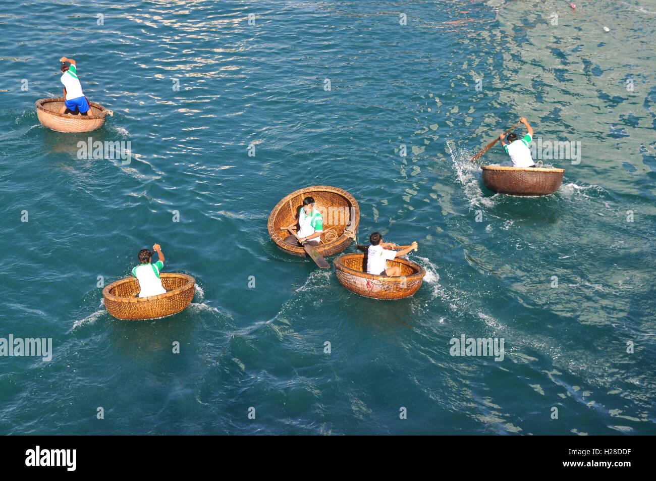 Nha Trang, Vietnam - July 14, 2015: Fishermen are racing by basket boats in the sea of Nha Trang bay - Stock Image