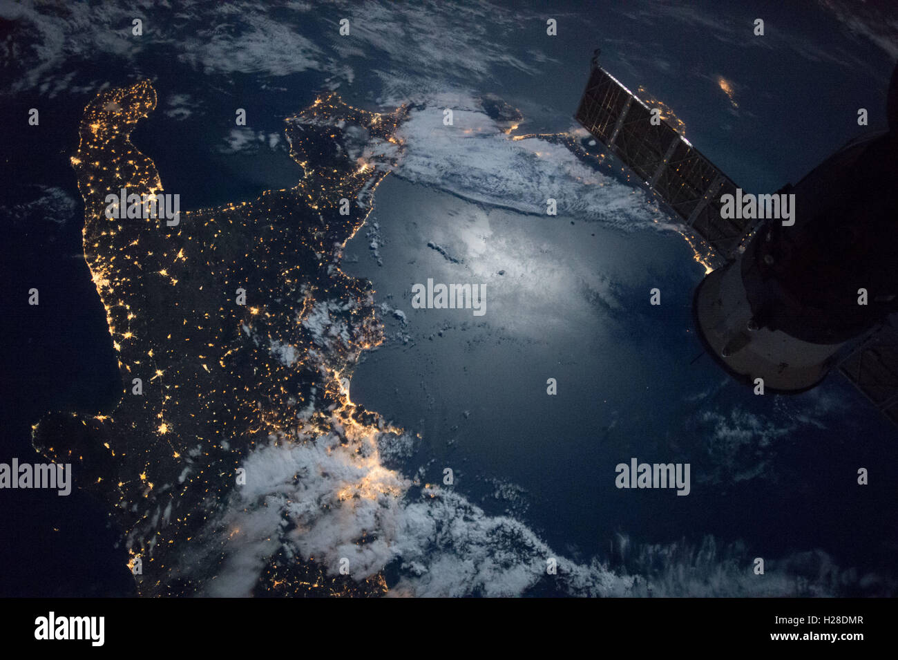 International Space Station Expedition 49 crew members capture a nighttime view of the southern tip of Italy September - Stock Image