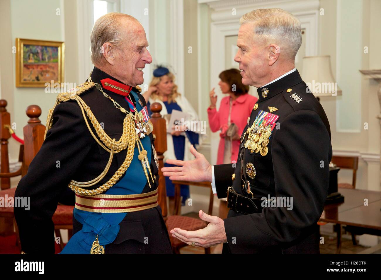 U.S. Marine Corps Commandant General James F. Amos chats with the Duke of Edinburgh Prince Philip during a reception Stock Photo