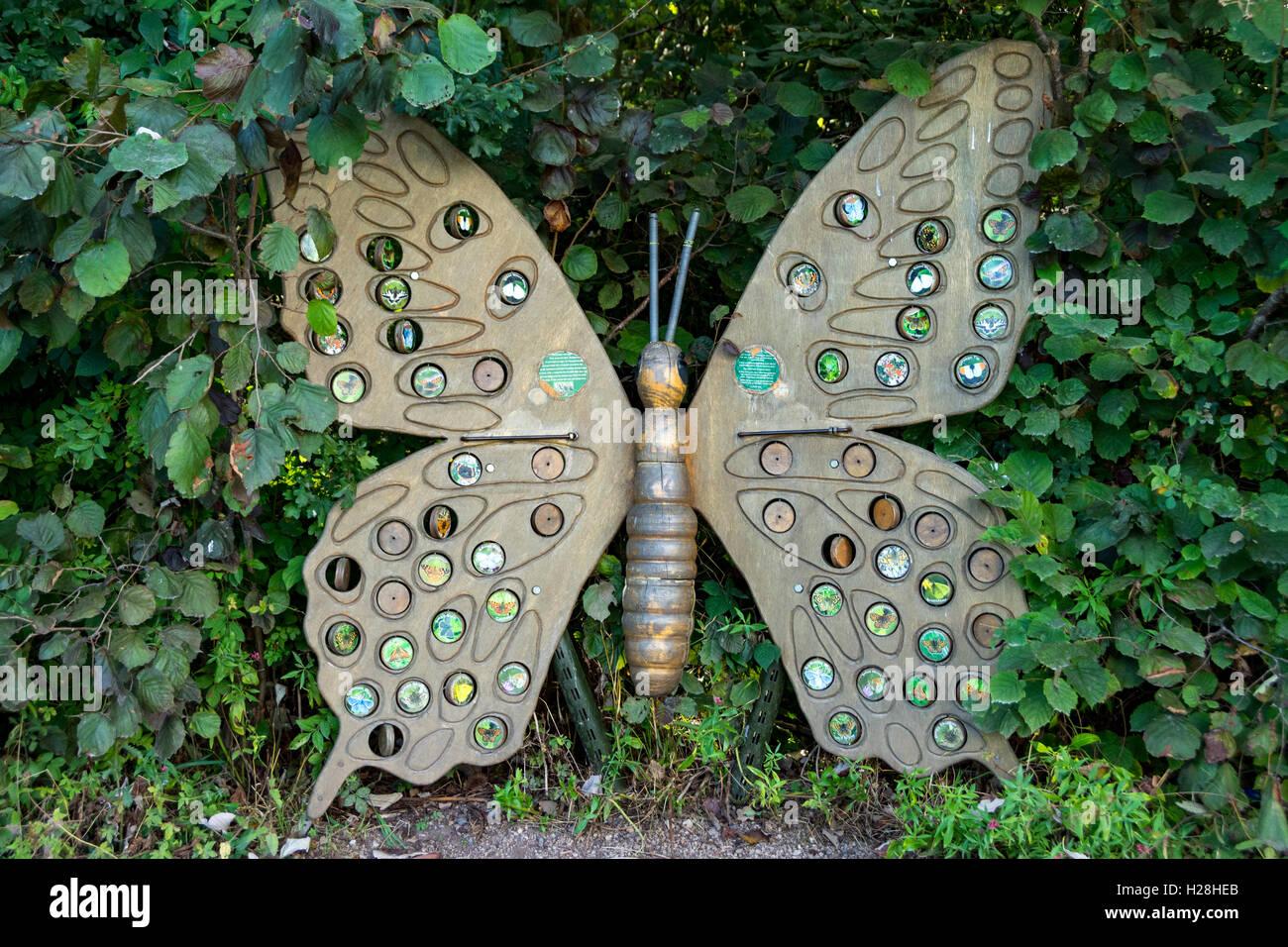 Wooden carved stylised insect, Rushcliffe Country Park, Ruddington, Nottingham, England, UK - Stock Image