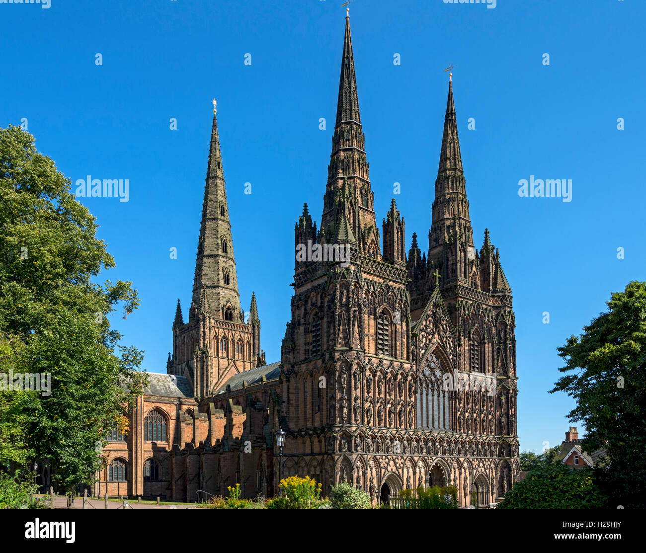 The West Front and spires of Lichfield Cathedral from the north west, Lichfield, Staffordshire, England, UK - Stock Image