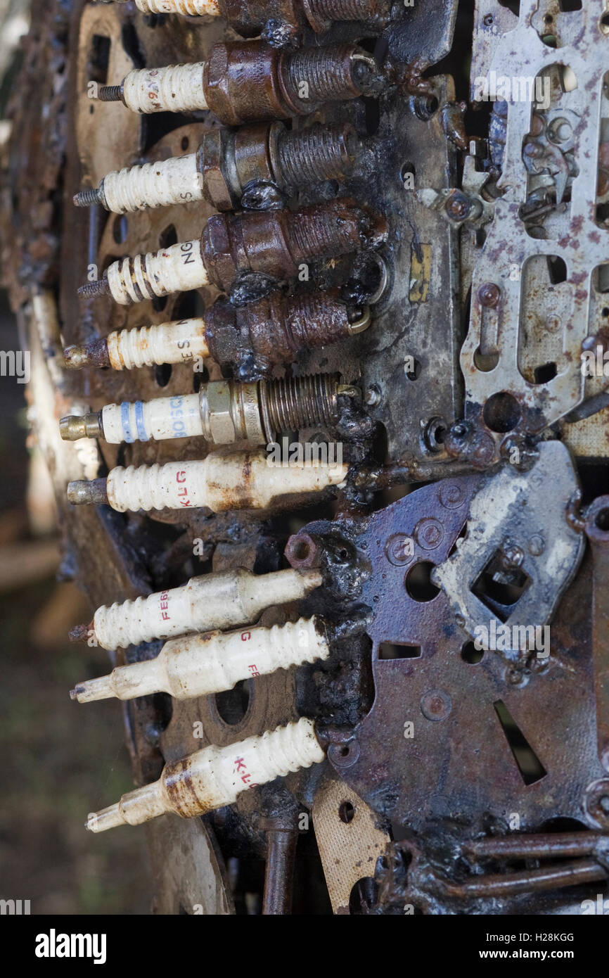 Sculptures made from car parts and old spark plugs Stock Photo