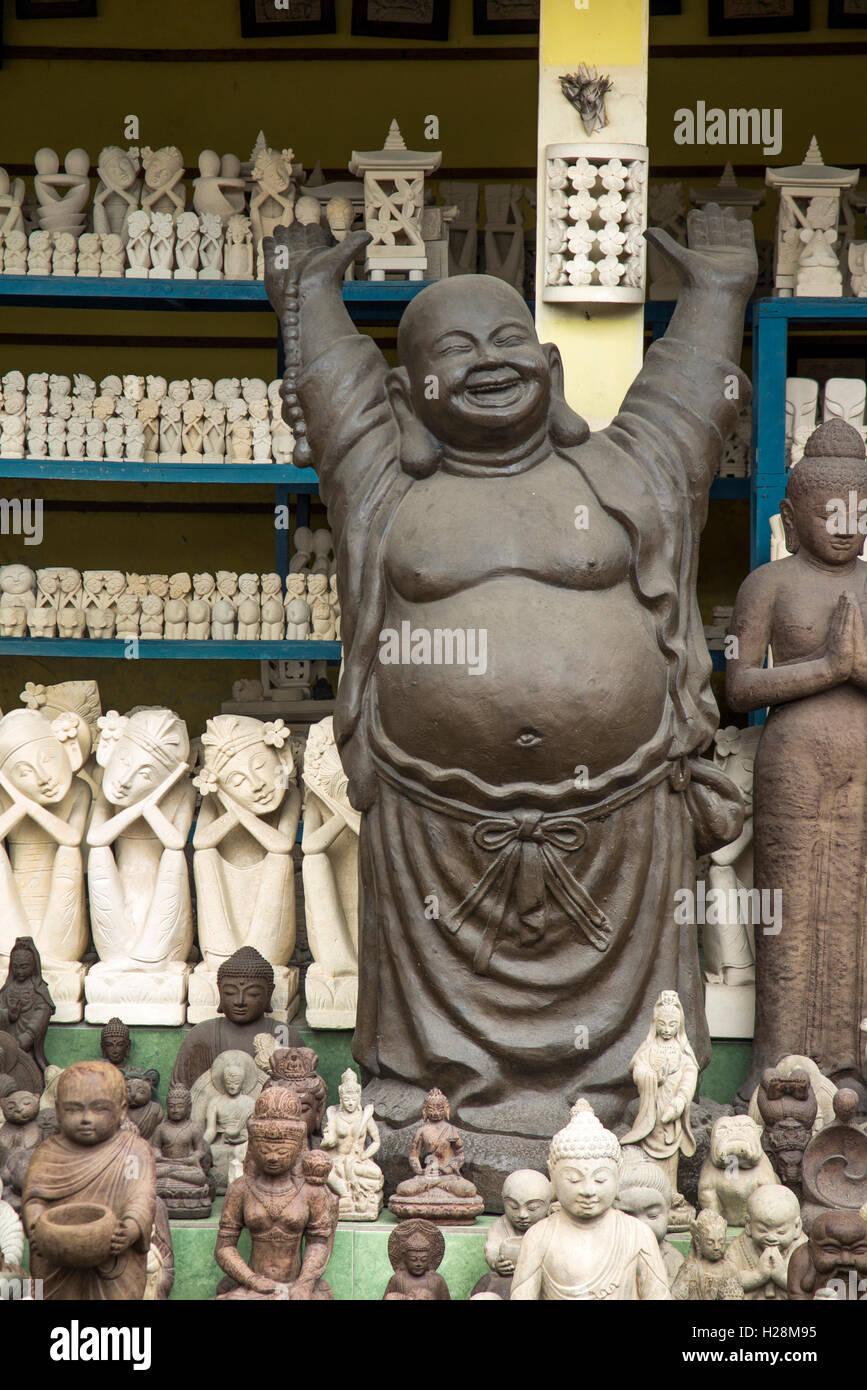 Indonesia, Bali, Ubud, Peliatan, Jl. Raya Andong, Happy Jolly with Raised Arms in craft shop - Stock Image