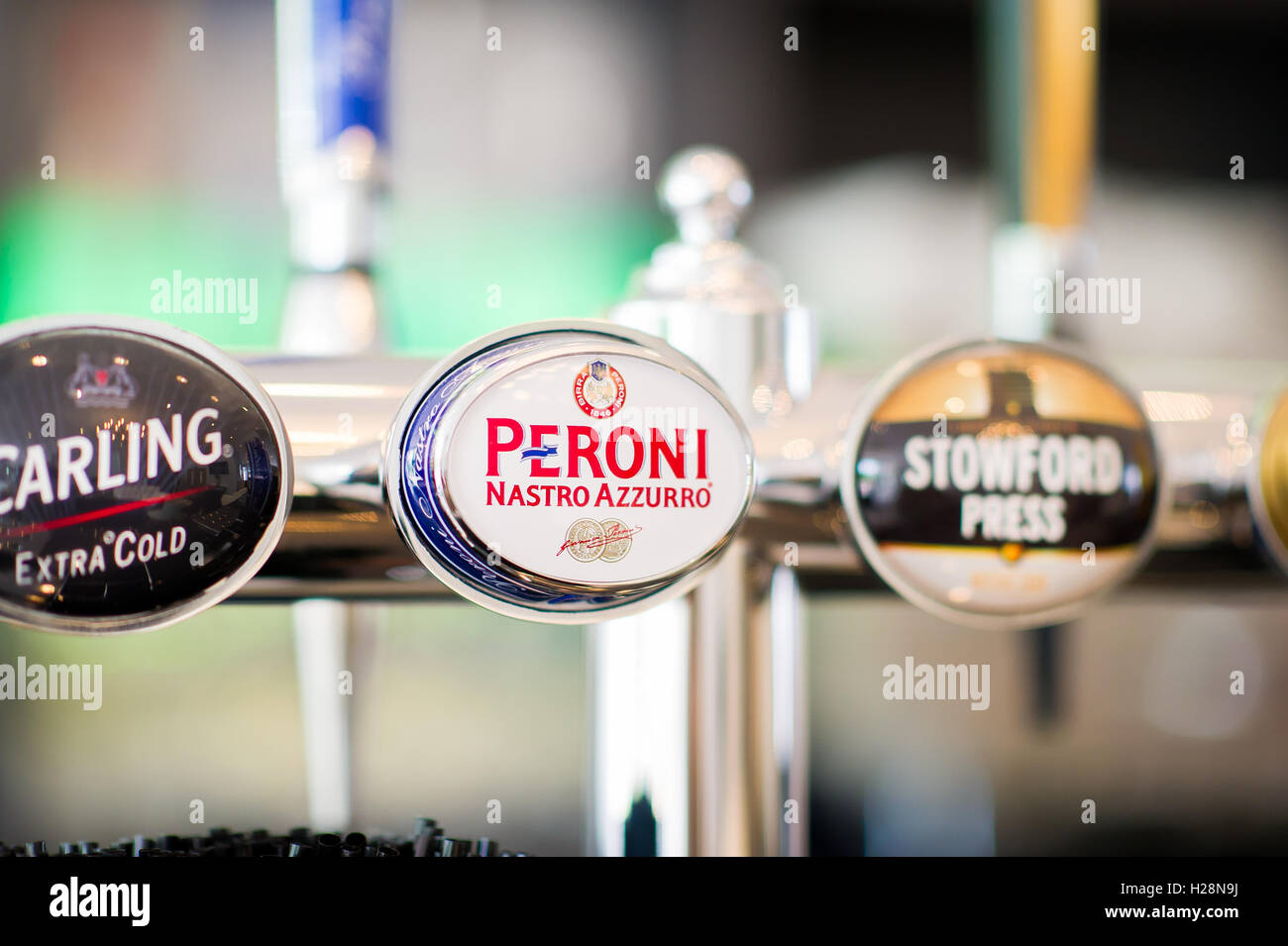 Draught lager beer taps - Stock Image