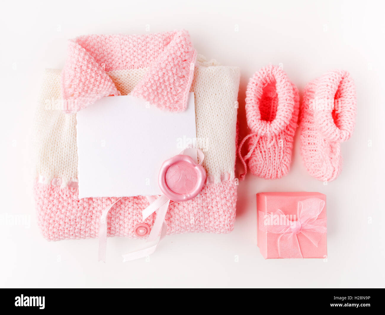 Socks and cloth-pants for baby newborn on white background. Children apparel concept. Flat lay, Top view - Stock Image
