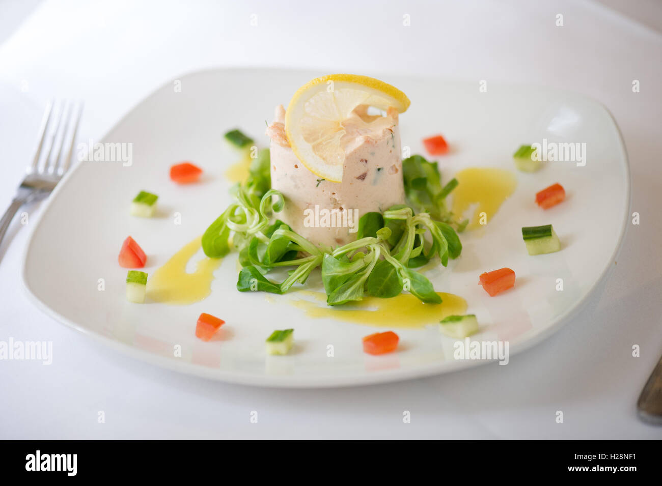 Light starter of mousse with salad - Stock Image