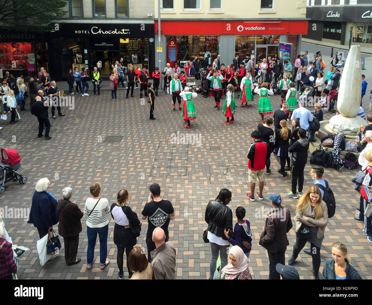 Morris dancers performing, Albert Street. In Nottingham, England. - Stock Image