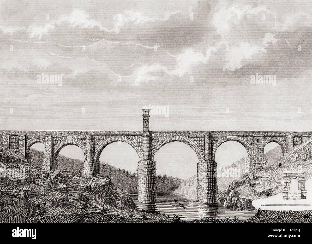 The Alcántara Bridge, aka Trajan's Bridge at Alcantara, Spain.  Second century Roman stone arch bridge - Stock Image