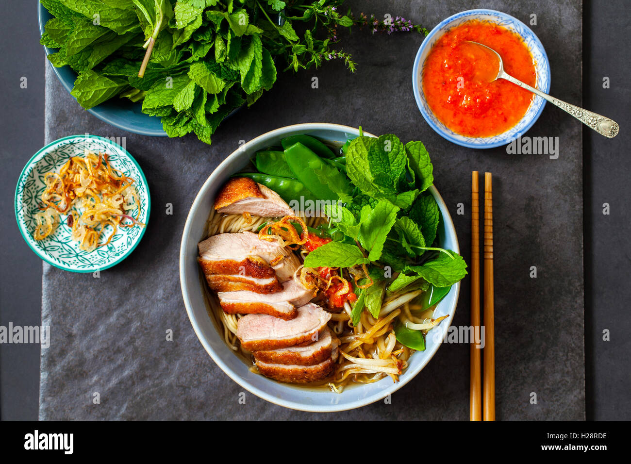 Vietnamese pho with duck with crispy skin, bean sprouts and
