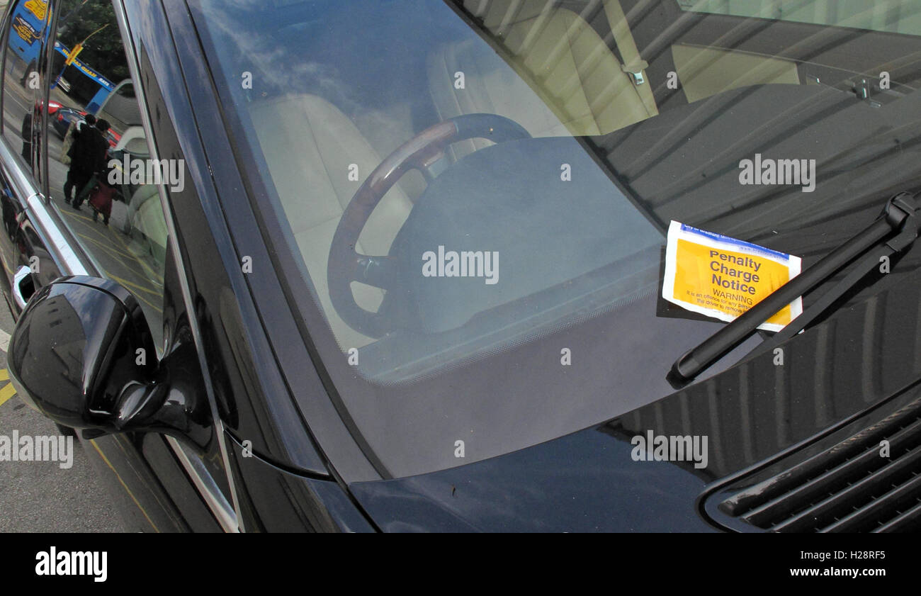 Black car with Penalty Charge Notice, parking ticket - Stock Image