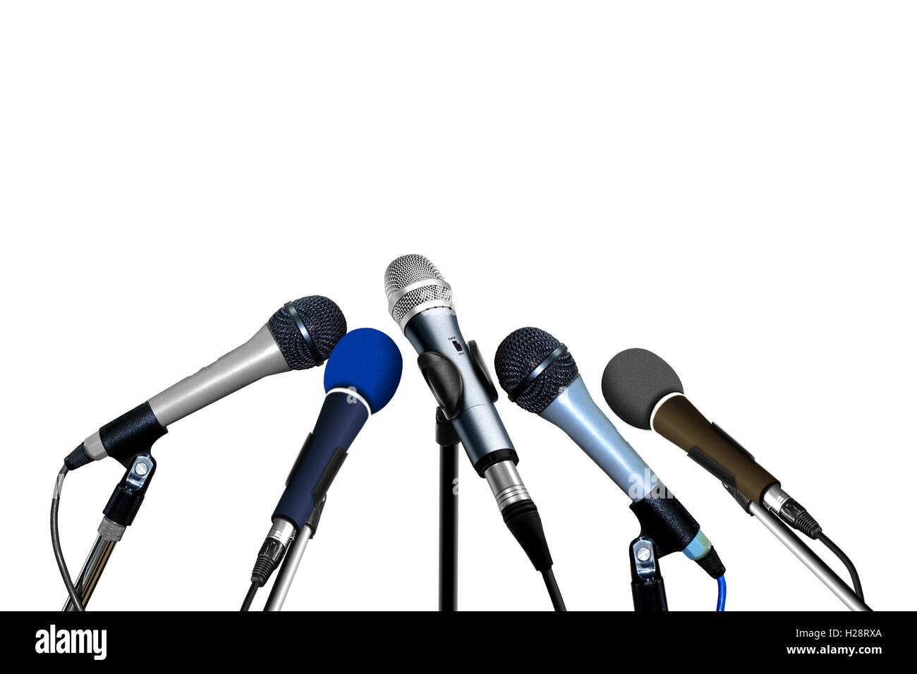 Press Conference Microphones over White - Stock Image