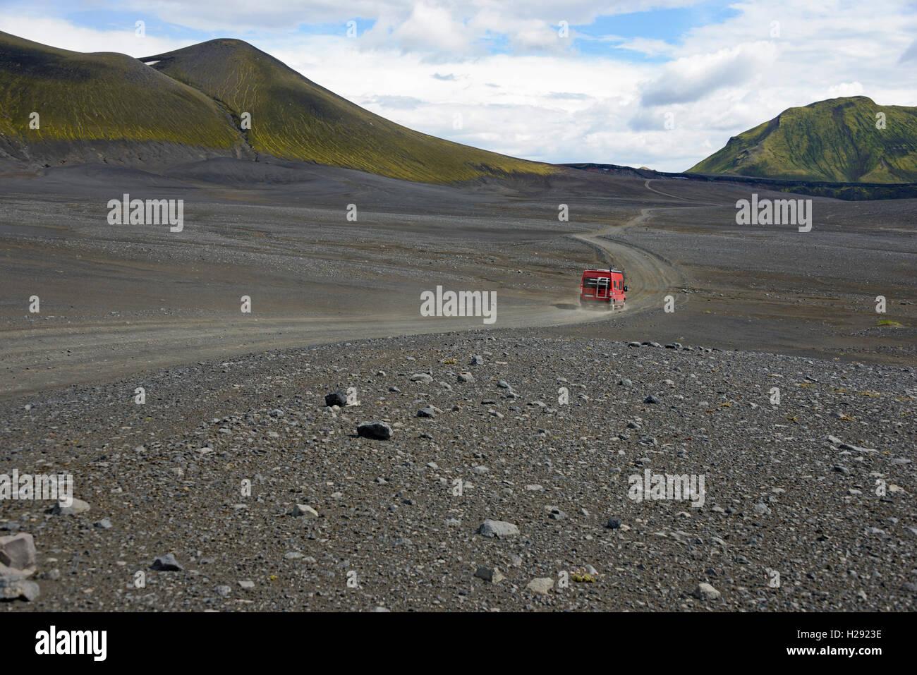 Caravan on dirt road in barren volcanic landscape, F208, Fjallabak National Park, Iceland - Stock Image