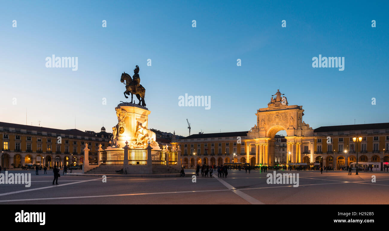 Arco da Vitoria, equestrian statue of King Joseph I at Praça do Comércio, dusk, Lisbon, Portugal - Stock Image