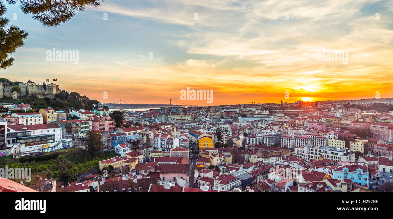 View across Lisbon, São Jorge Castle, sunset, Graça viewpoint, Lisbon, Portugal - Stock Image