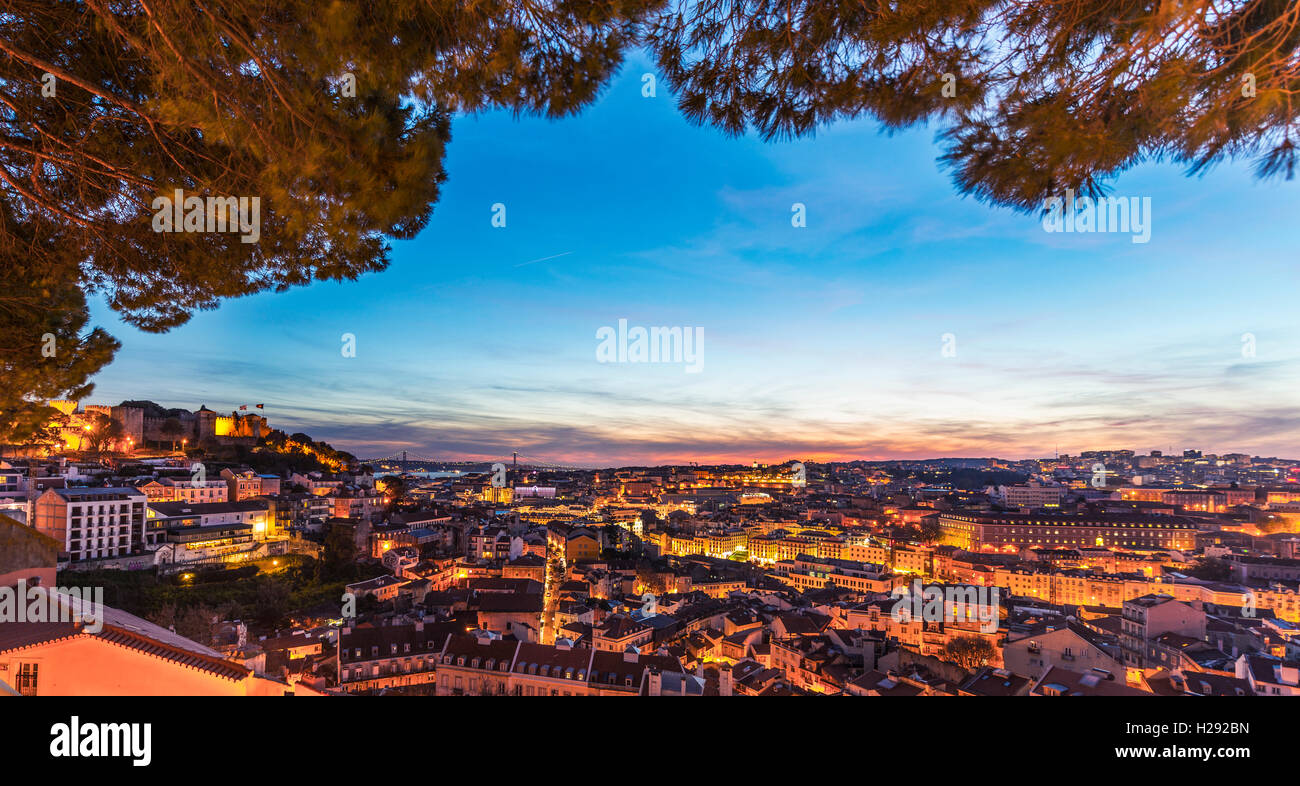 View across Lisbon, São Jorge Castle at dusk, Graça viewpoint, Lisbon, Portugal - Stock Image