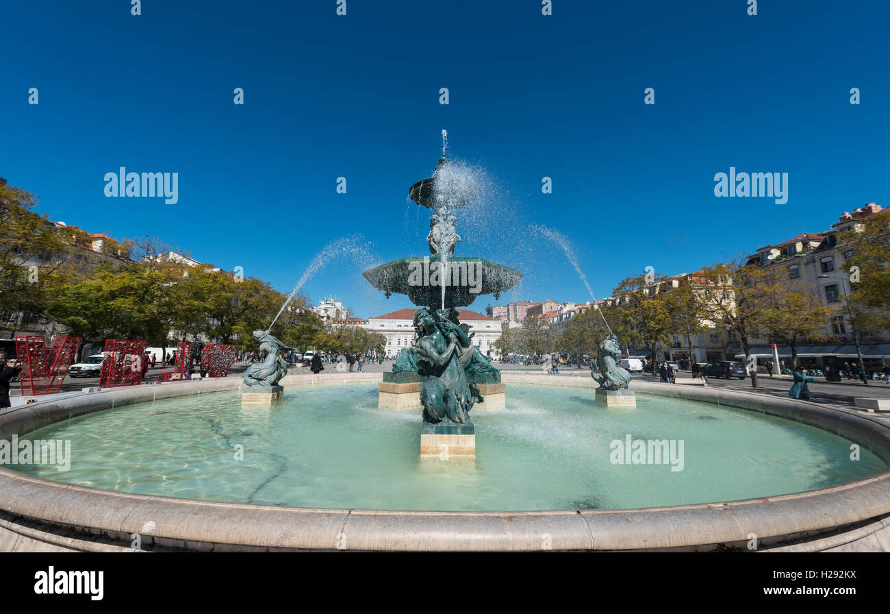 Fountain, bronze fountain at Rossio Square, Lisbon, Portugal - Stock Image