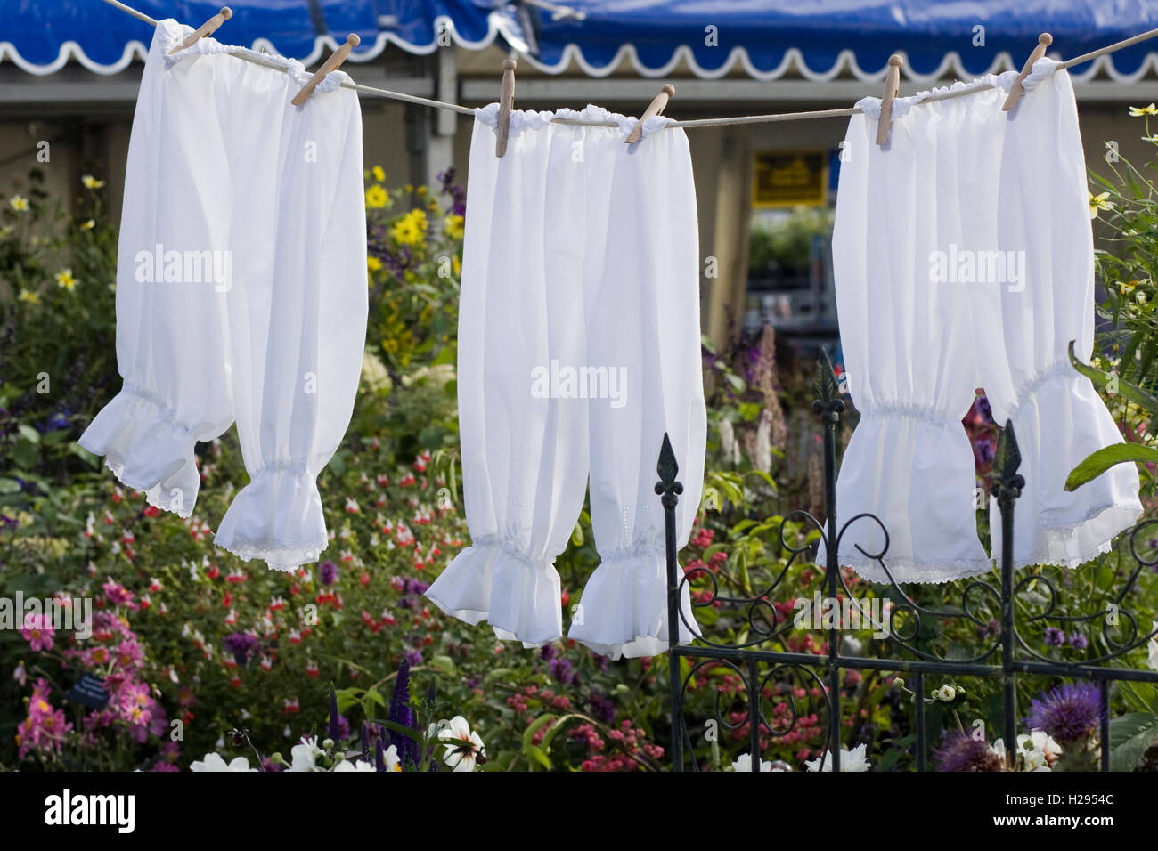 Laundry Hanging on a washing line in the garden - Stock Image