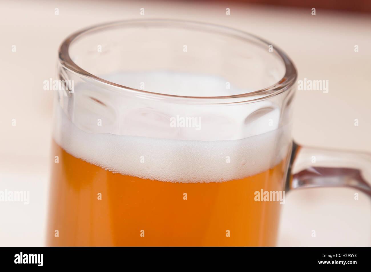 Mug of draft beer close up - Stock Image