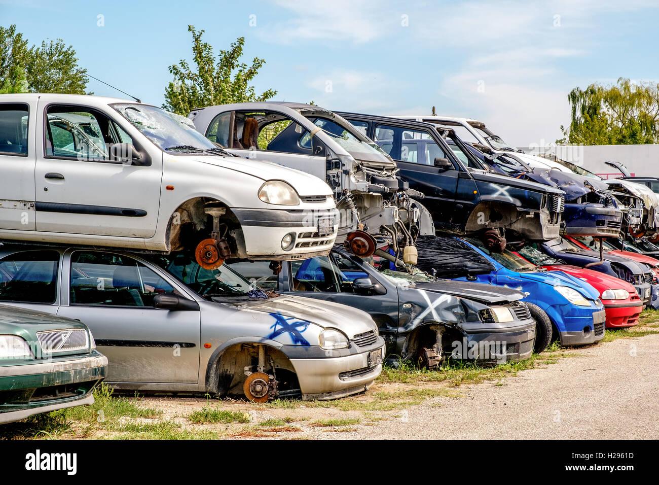 crashed cars junkyard - Stock Image