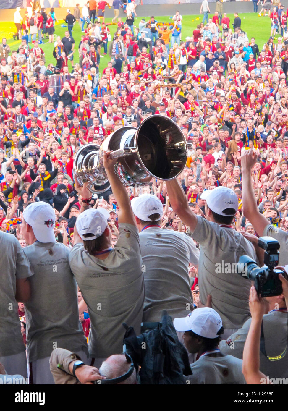 Sparta Prague foootball players team group celebrating the victory and become champion of game while holding win Stock Photo